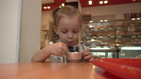 brulee : Little cute girl eating a delicious sweet dessert at the cafe. Creme brulee. Happy childhood. Childrens pleasures
