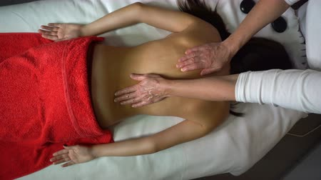 regenerating : Spa treatments. Back massage. Massage zone of spine. Moistening with oil. Healing procedures