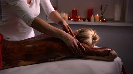 revitalizing : Spa treatments. Back massage with moisturizing mask. Masseur work process. Deep moisturizing and restorative procedures. Scrub with yogurt and chocolate for body