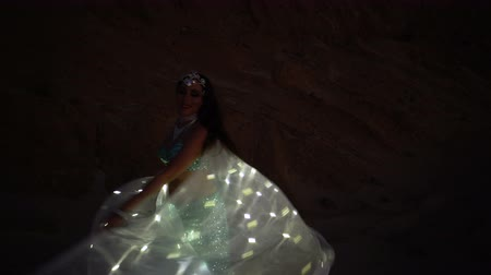 butterflies in the stomach : Oriental beauty dancing belly dance with glowing wings. Delightful and alluring grace of movements. Girl dancing in the desert at night.