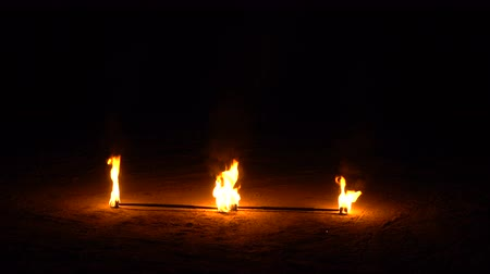 манипуляция : Fire show. Two burning torches lie on the ground. Night show. Street performance.
