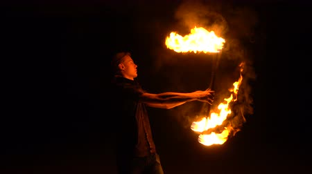 ustalık : Fire performance. Man juggles with two lit torches. Night show. Mastery of fakir.