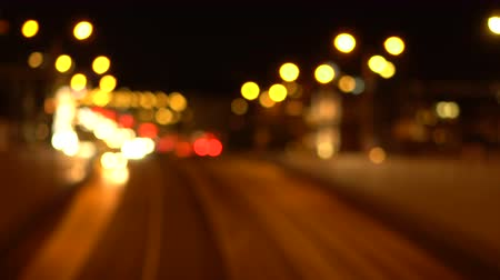 Bokeh night city streets. Out of focus. Busy traffic on the city highway. Headlights. Top view. Blurred urban background.
