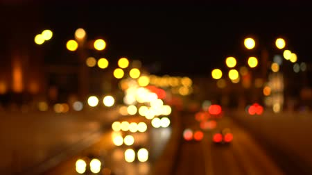 Bokeh night streets of the city. Out of focus. Busy traffic on the city highway. Headlights. Top view. Blurred urban background.