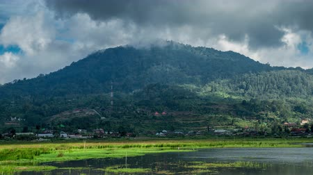 bratan : Clouds over the mountains in near Buyan lake. 4K Timelapse Stock Footage