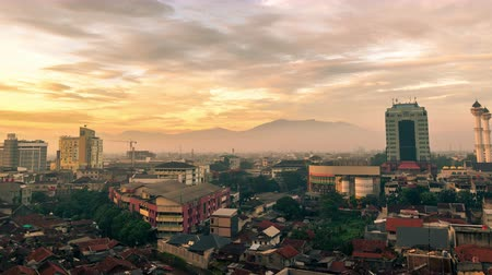 Aerial view Dawn in the city of Bandung. 4K Timelapse - Bandung, West Java, Indonesia, June 2016. Стоковые видеозаписи