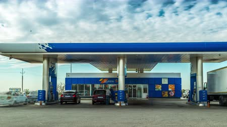 gazprom : Many Cars refuel at the gas station Gazpromneft in Kazakhstan. Timelapse
