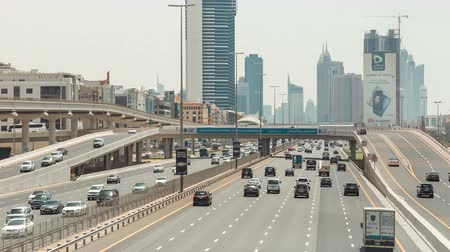 busiest : Nonstop traffic at Sheikh Zayed road, time lapse from above carriageway. Seven lane in each direction Stock Footage