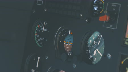 бортовой : Helicopter cockpit, high-tech dashboard, pilots operating plane Стоковые видеозаписи