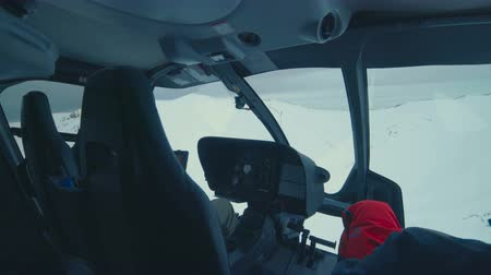 рукоятка : POV from the inside of a helicopter flying over snow mountains