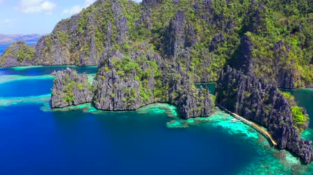 Aerial view Tropical lagoon with azure water and high mountain limestone formation. Coron, Busuanga Philippines. Wideo