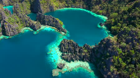 Aerial view Tropical lagoon with azure water with sailing boats near Kayangan and Barracuda Lake. Coron, Busuanga Philippines.