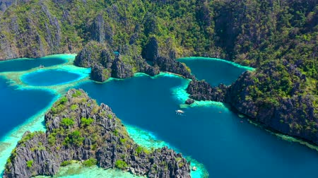 pristine : Aerial view Tropical lagoon with azure water with sailing boats near Kayangan and Barracuda Lake. Coron, Busuanga Philippines.