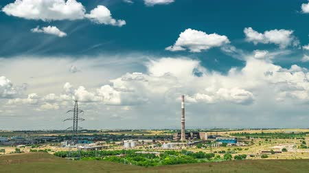 Industrial landscape - thermal power station with blue cloudy sky Stok Video