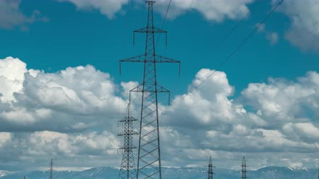 High voltage post tower with blue cloudy sky background
