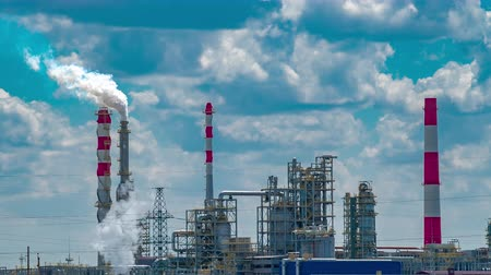 petroleum refinery : Refinery tower in petrochemical industrial plant with cloudy sky Stock Footage