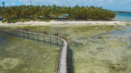 Wooden pathway over the water leading to the viewing deck for the surfing competition. July 2019 - Siargao island, Philippines Стоковые видеозаписи