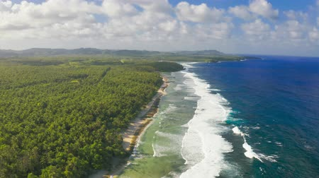 Aerial view tropical beach island and sea bay lagoon, Siargao. Tropical landscape hills and mountains rocks with rainforest palm. Стоковые видеозаписи