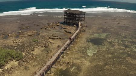 Raised wooden walkway for surfers to cross the reef of siargao island to Cloud 9 surf break in Mindanao the Philippines