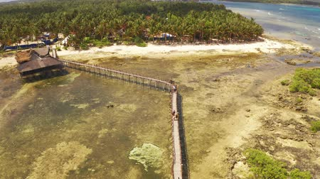 People going to the Sufr tower at Cloud 9, Siargao, Philippines Стоковые видеозаписи