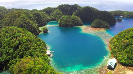 Tropical sea bay and lagoon, beach in Bucas Grande Island, Sohoton Cove, Philippines. Tropical landscape hill, mountains rocks with rainforest and azure water of lagoon.
