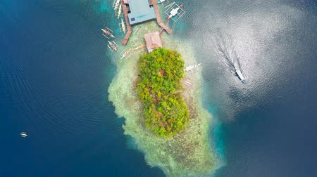 siargao island : Aerial top view Boat pier in a beautiful tropical bay on Sugba lagoon in Siargao, Philippines.