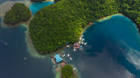 Aerial top view Boat pier in a beautiful tropical bay on Sugba lagoon in Siargao, Philippines.