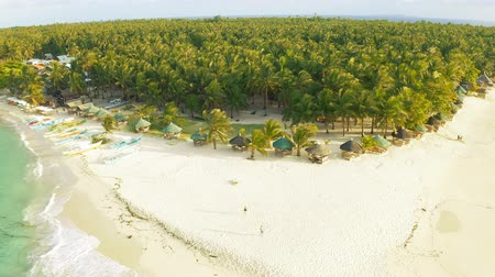island hopping : Aerial View of paradise white sand beach and azure sea on tropical Daku Island in Siargao, Philippines