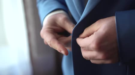 polegar : A man putting on a jacket Stock Footage