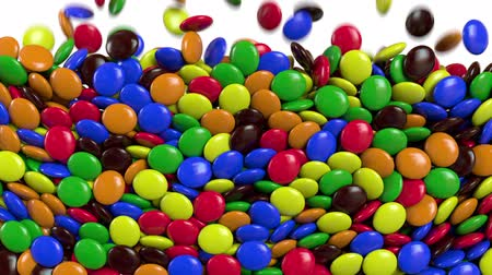 abundância : Round colored candies are falling. Alpha channel. 3D rendering