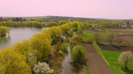 Beautiful aerial view footage of river and village