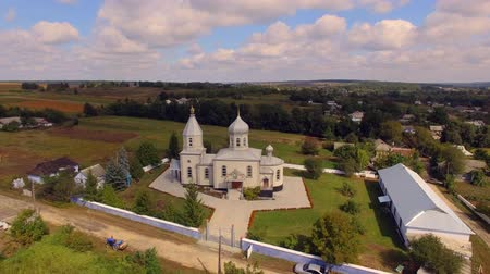 torre sineira : Orthodox church in the Ukrainian village. Aerial view. Stock Footage