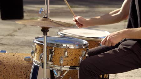 playing drums in a beautiful sunny day Stock Footage