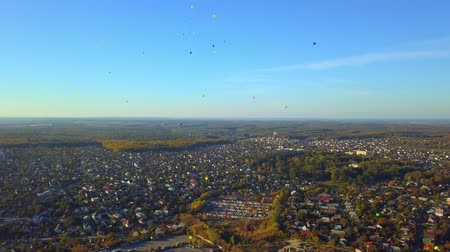 aerial view of colorful balloons over the city Wideo