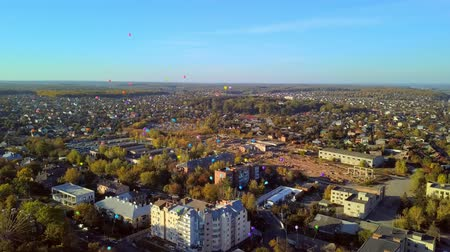 aerial view of colorful balloons over the city Stock Footage