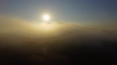 Aerial View. Flying over the beautiful mountain in clouds. Aerial camera shot. Sunrise. Landscape panorama. Stock Footage