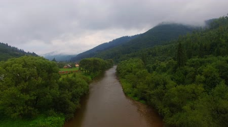 Aerial View. Flying over the beautiful mountain River. Aerial camera shot. Landscape panorama.