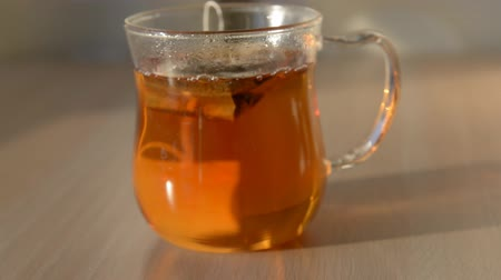 teabag : hot water over teabag in cup Stock Footage