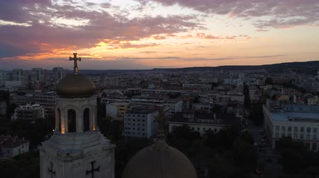 bulgaristan : Aerial view of The Cathedral of the Assumption in Varna, Bulgaria. Colorful Sunset. Stok Video