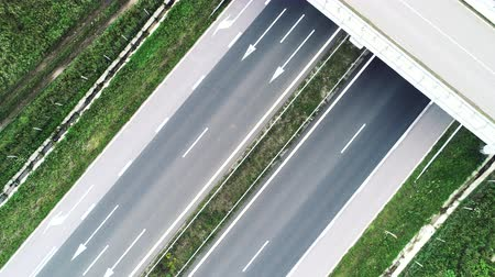 straight road : Driving on open road or highway in the countryside, aerial drone view Stock Footage