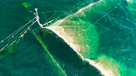 seashell : Fishing Nets in the sea water near the coast of the Black Sea in Varna, Bulgaria, aerial drone view.