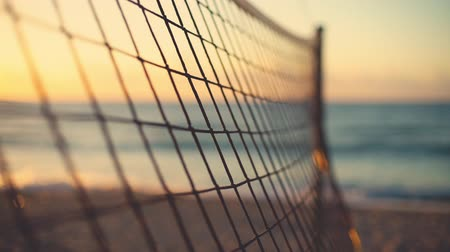залп : Volleyball net and beautiful sunrise on the beach Стоковые видеозаписи