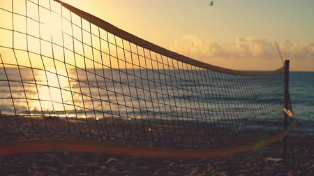 beach volleyball : Volleyball net and beautiful sunrise on the beach Stock Footage