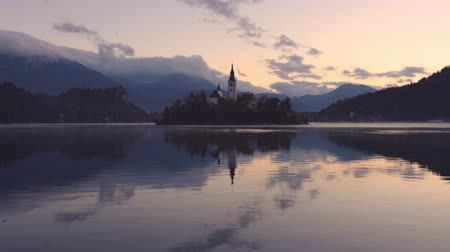 marys : Sunset over Lake Bled, Slovenia with St. Marys Church of the Assumption on the island Stock Footage