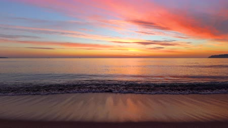 beach panorama : Sunrise over the sea waves. Beautiful cloudscape and beach, video