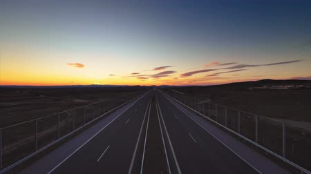 ahead : Driving on open road at sunset to the new year 2019. Aerial drone view.