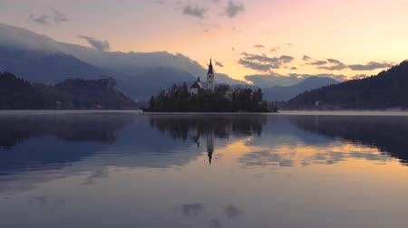 marys : Sunset and Lake Bled, St. Marys Church of the Assumption on island; Slovenia Stock Footage