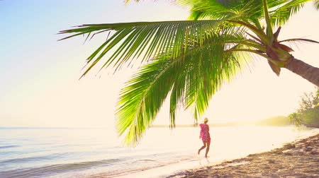 barbados : Woman running on tropical exotic beach. Summer  holiday. Stock Footage