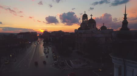 cars traffic : Aerial view of The Cathedral of the Assumption in Varna, Bulgaria. Sunset shot. Stock Footage