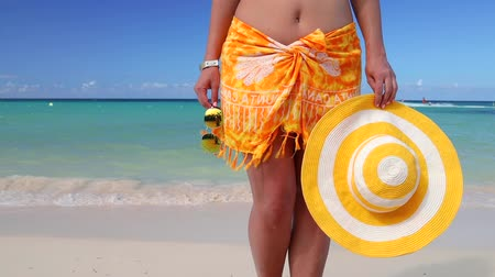 saona : Summer beach vacation. Sexy woman ass in bikini and scarf. White sand, blue sky and crystal sea of tropical island. Holiday at Paradise Stock Footage